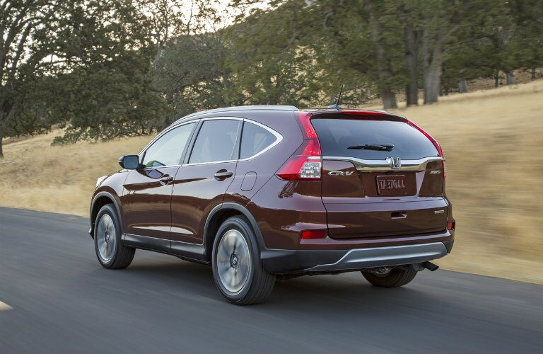2016 Honda CR-V exterior back fascia and drivers side on road with trees on side of road
