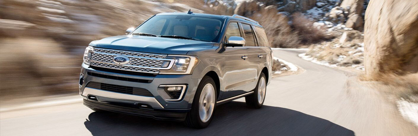 2018 Ford Expedition driving fast down a curving road