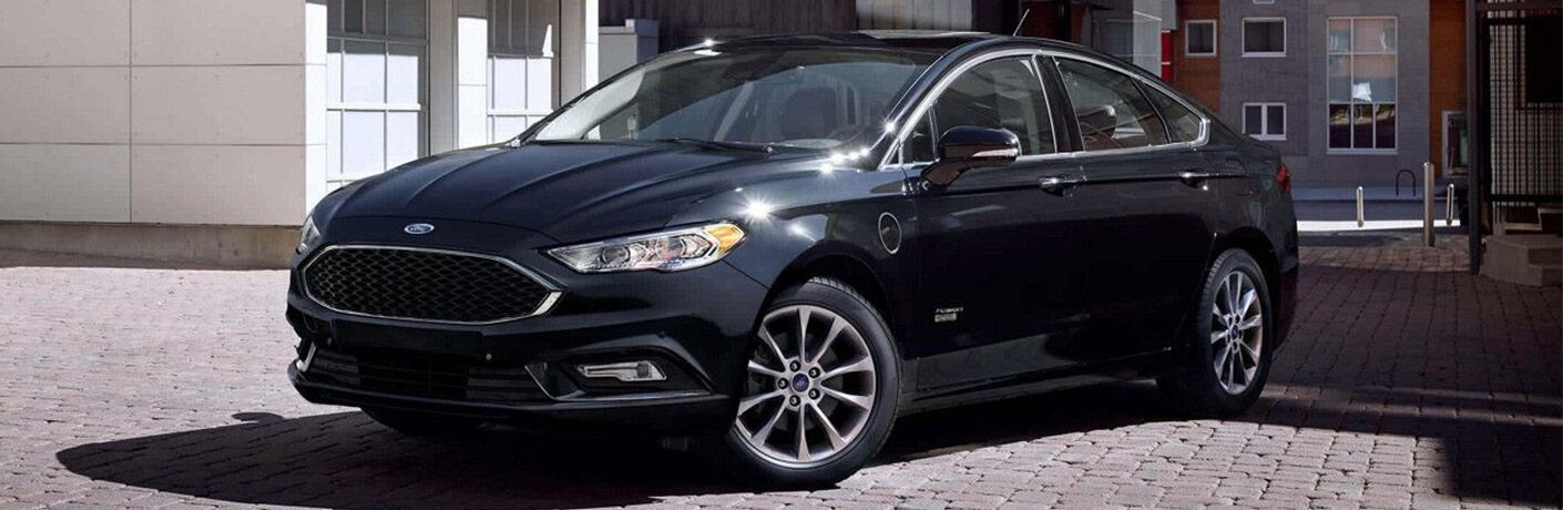 Black 2018 Ford fusion parked on a cobblestone road