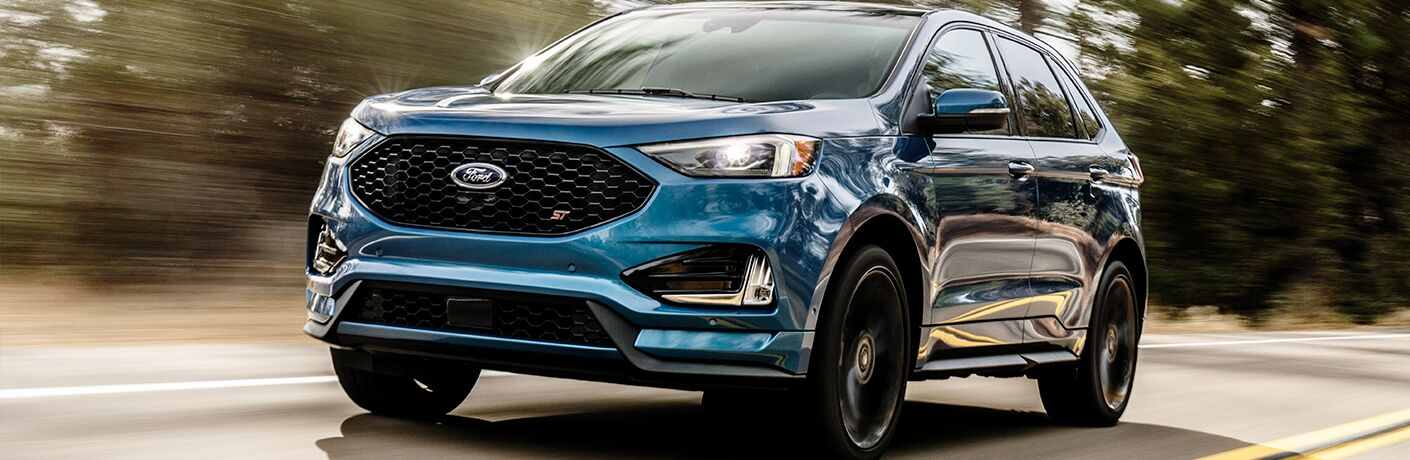 Blue 2019 Ford Edge ST driving down the highway