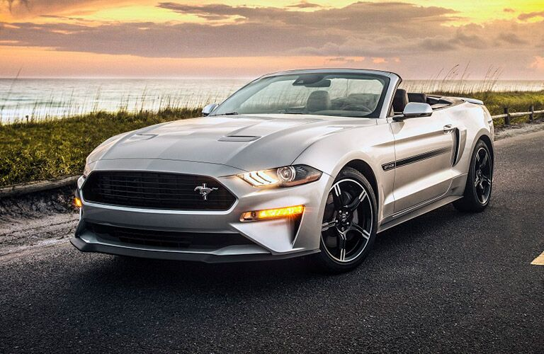 2019 Ford Mustang parked on a road near the shore