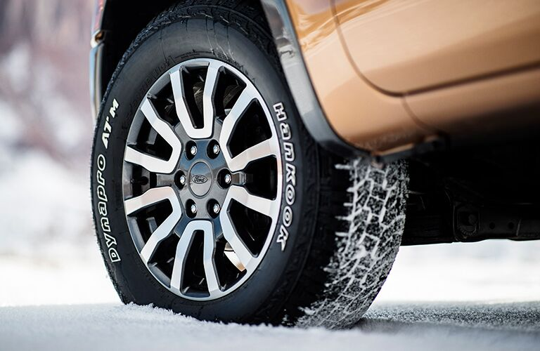 Close up of Ford Ranger tire in the snow