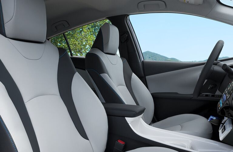 Two front seats in the interior of a Toyota Prius.