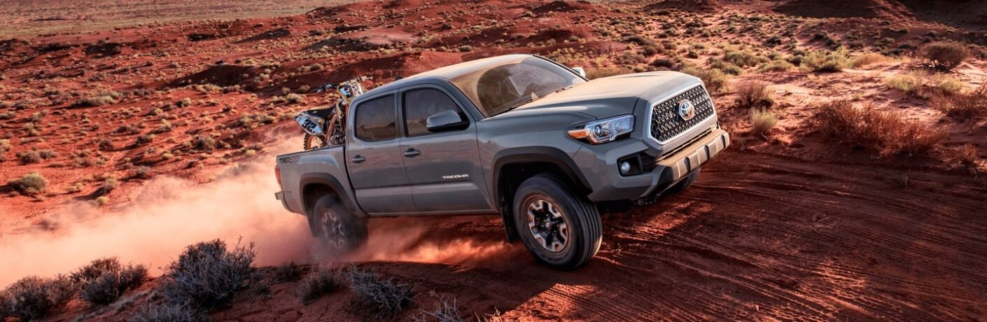 2019 Toyota Tacoma driving off road in sand dune