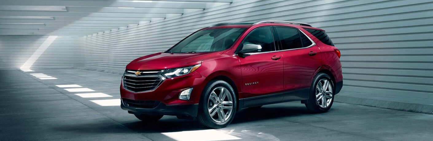 red Chevy equinox in a metal garage