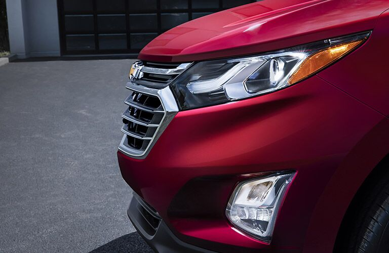 closeup view of Chevy Equinox chrome grill and headlights