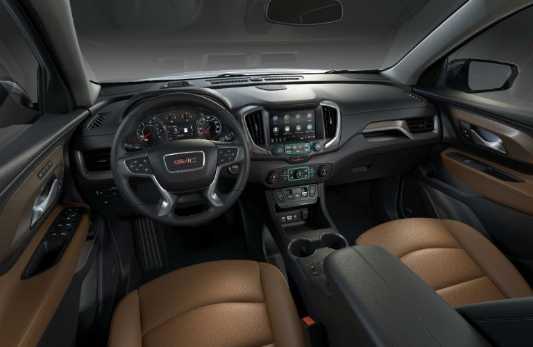 interior view of GMC Terrain dashboard and brown seats