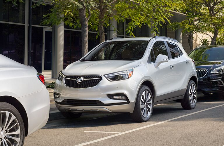 white buick encore parked on the side of a street