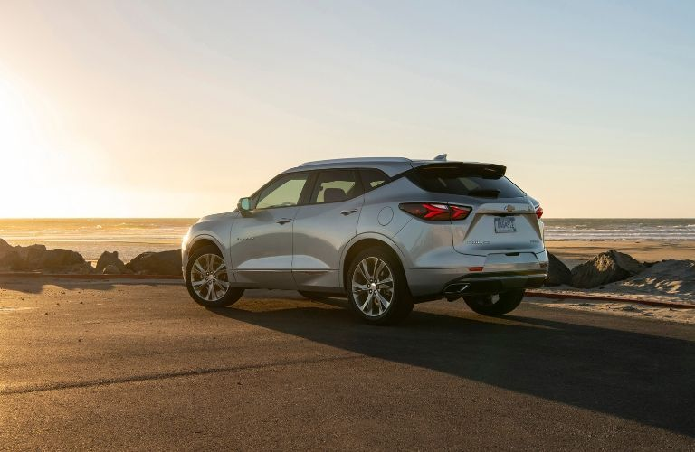 2019 Chevrolet Blazer parked on a beach at sunset