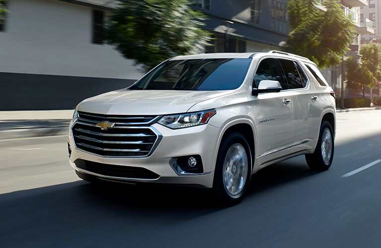 2019 Chevrolet Traverse driving down a city street
