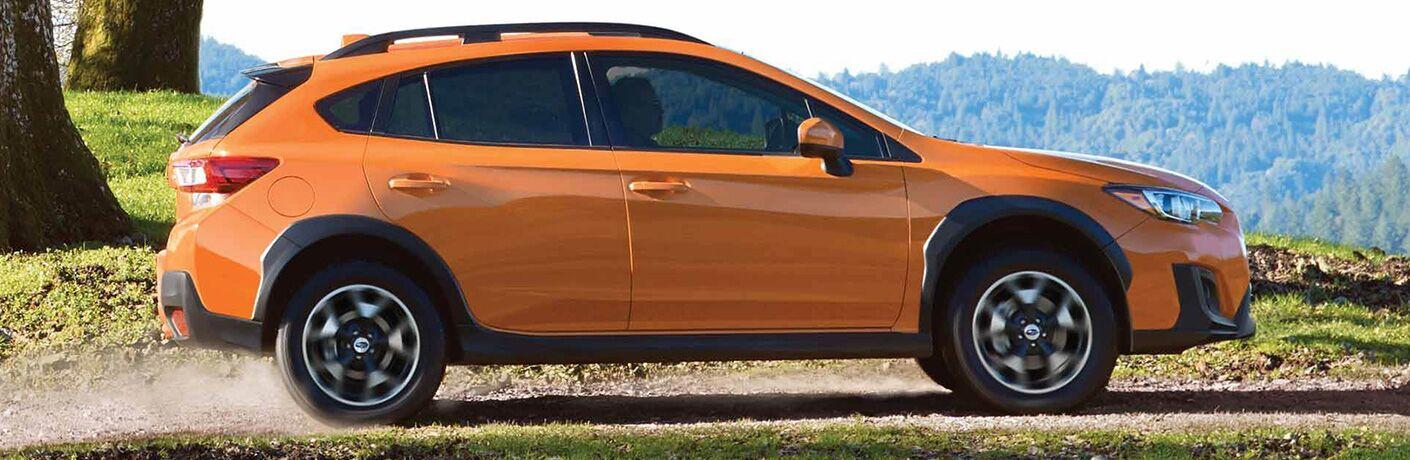 side view of orange Subaru crosstrek