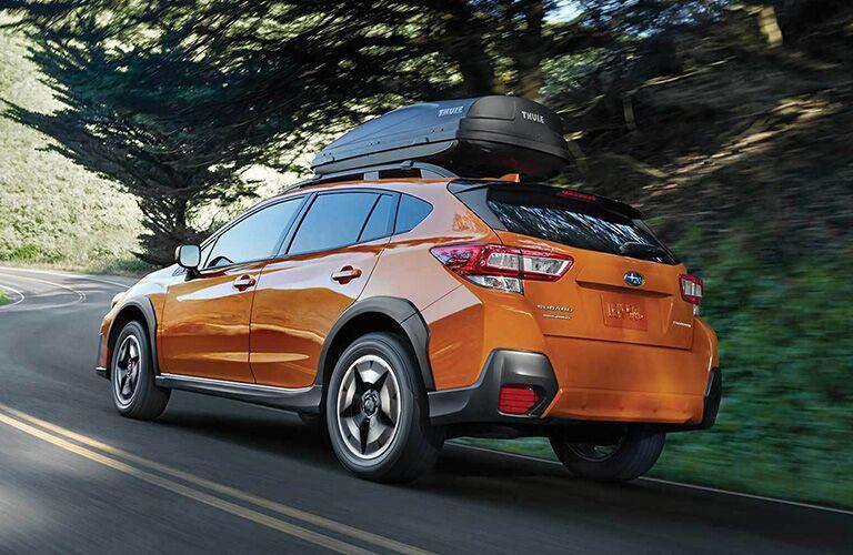 2019 Subaru Crosstrek driving down a winding road