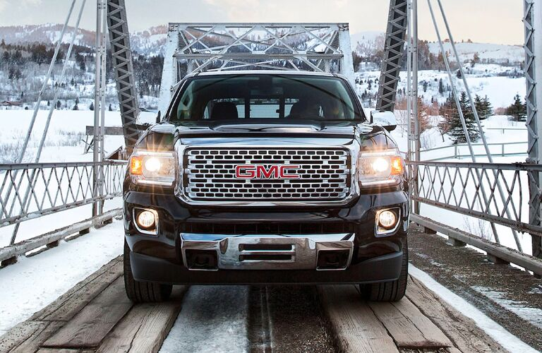 2020 GMC Canyon driving on a snowy bridge