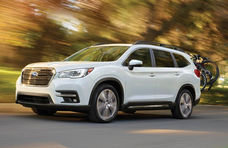 2020 Subaru Ascent driving down a forest road