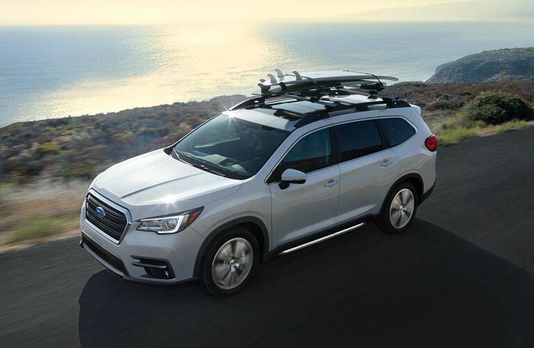 2020 Subaru Ascent driving down an oceanside road