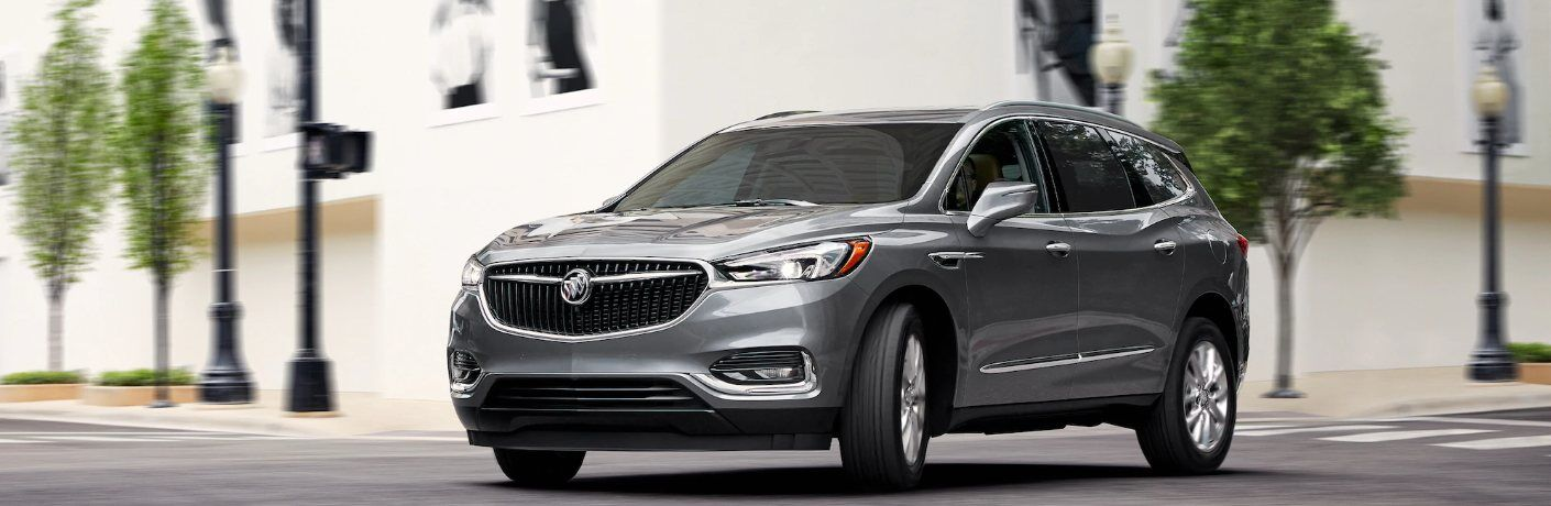 2020 Buick Enclave driving down a city street