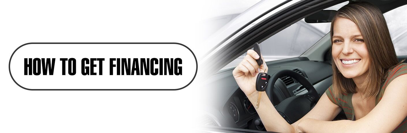 "smiling woman in car with keys, title of ""How to get financing"""