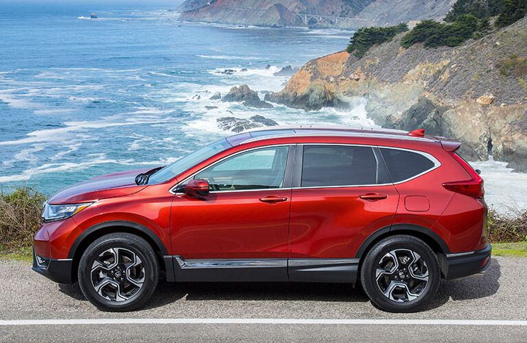 red 2019 cr-v parked in front of water