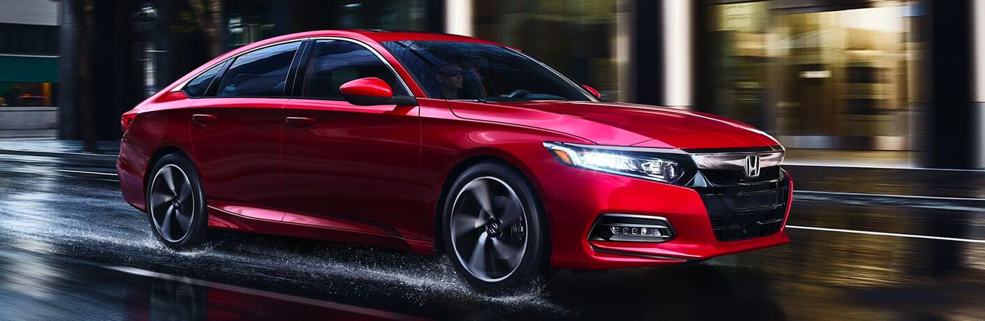2020 Honda Accord driving through wet city streets