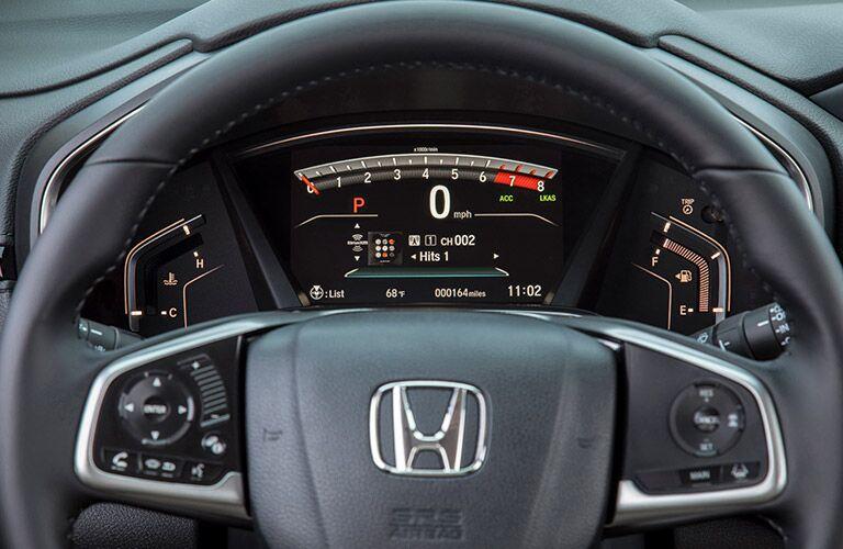 2019 Honda CR-V interior closeup of steering wheel and driver information interface
