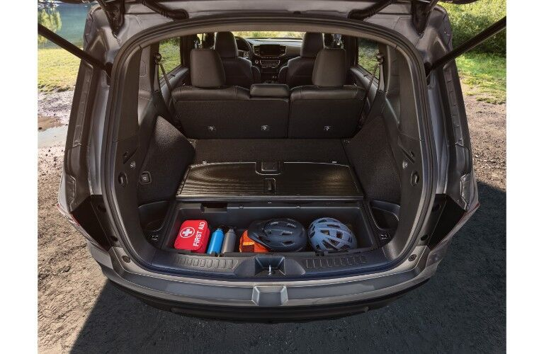 2019 Honda Passport exterior and interior shot of open trunk and adjustable cargo space with underfloor compartment open