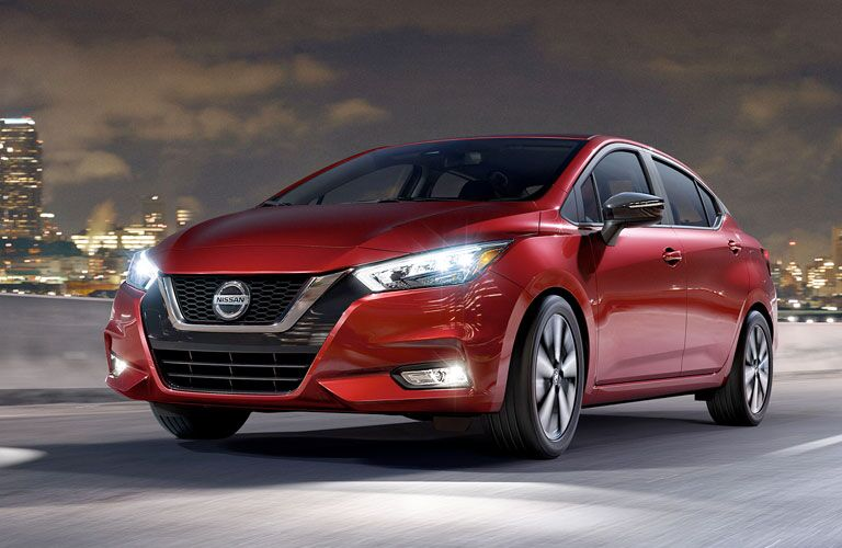 Front view of red 2020 Nissan Versa on city road