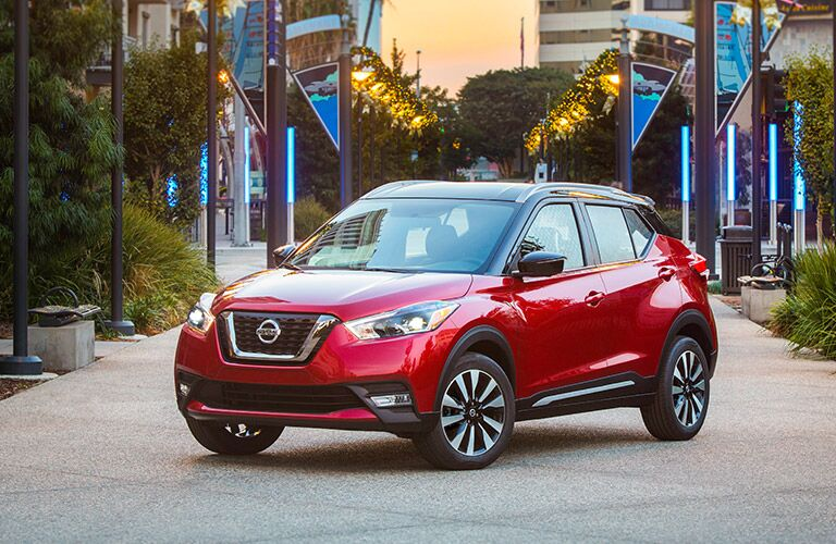 2018 Nissan Kicks parked in a courtyard at dusk