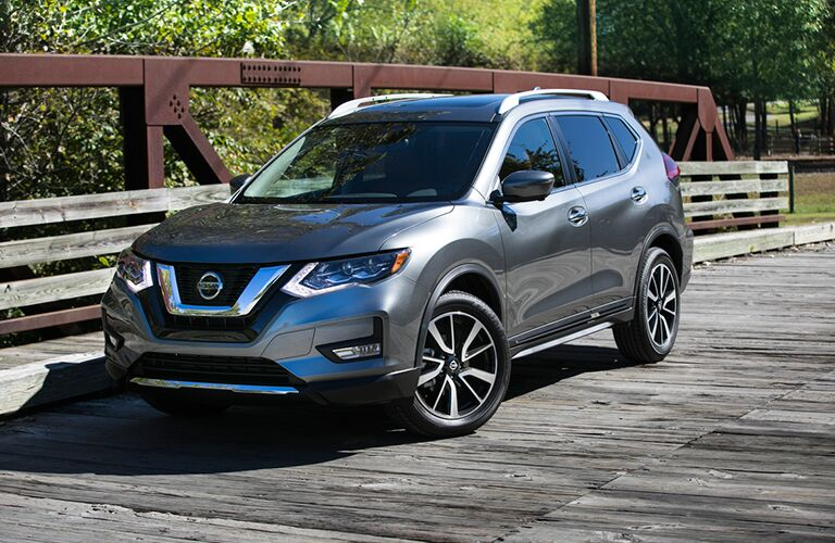 2018 Nissan Rogue gray paint angled front shot on bridge