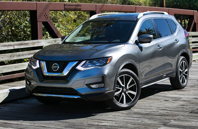 2018 Nissan Rogue parked on a wooden bridge