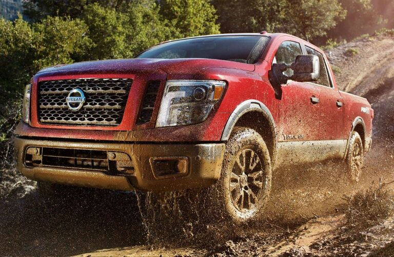 2018 Nissan Titan driving through mud