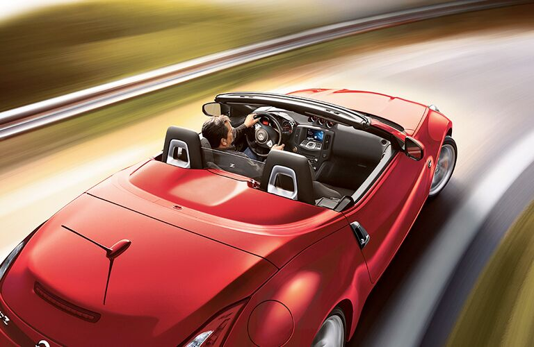 2019 Nissan 370Z Roadster with top down driving on a road