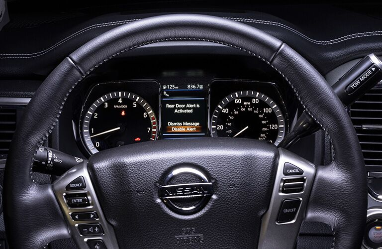 Steering wheel mounted controls and driver information cluster of the 2019 Nisan Titan