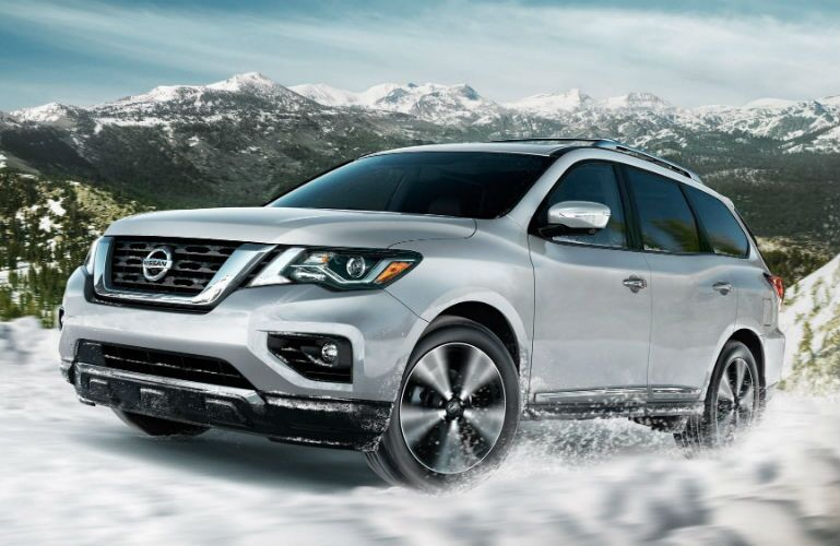 2019 Nissan Pathfinder Platinum 4WD in Brilliant Silver Metallic driving through snow