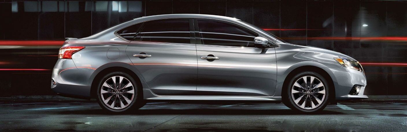 2019 Nissan Sentra with lights streaking as it drives