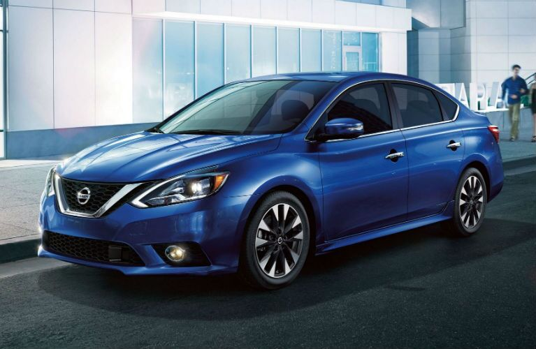 2019 Nissan Sentra SR in Deep Blue Pearl parked by a curb