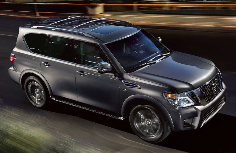 Side view of grey 2020 Nissan Armada on the road