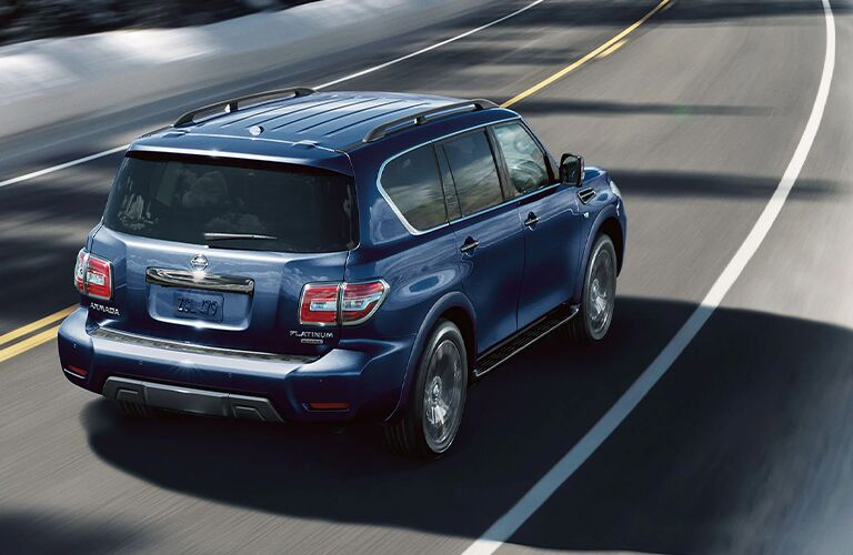Rear view of blue 2020 Nissan Armada on the road