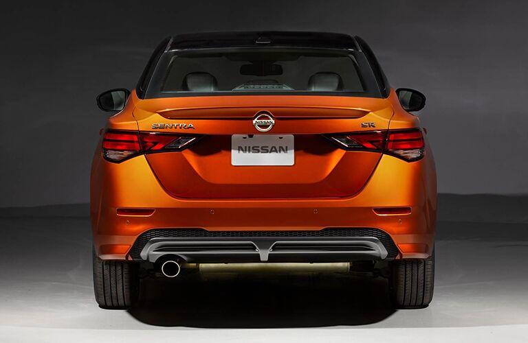 Rear view of orange 2020 Nissan Sentra