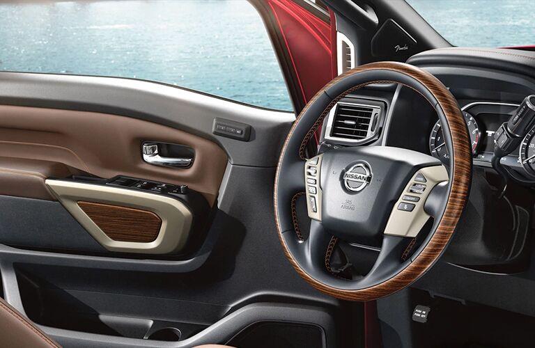 Steering wheel and open door of 2020 Nissan Titan with upgraded interior accents