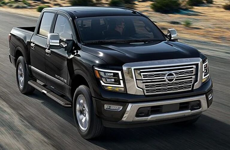 Front view of black 2020 Nissan Titan speeding on the road