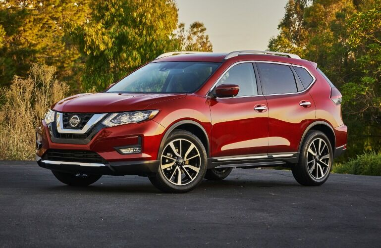 2020 Nissan Rogue with green and yellow trees behind