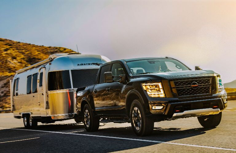 Black 2021 Nissan Titan Towing a Trailer