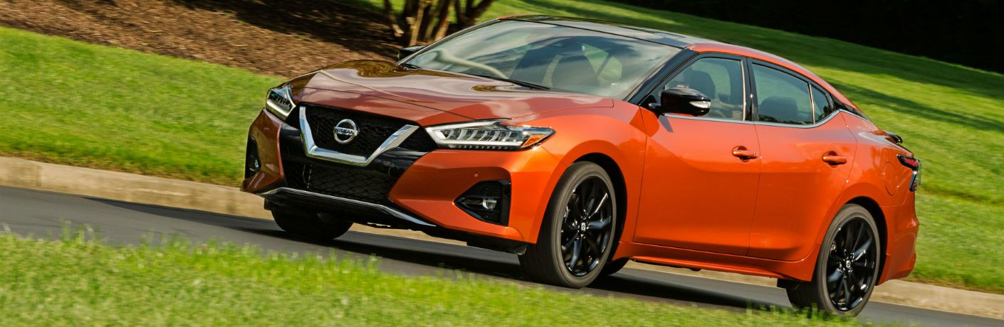 A left profile photo of the 2020 Nissan Maxima parked on the road.
