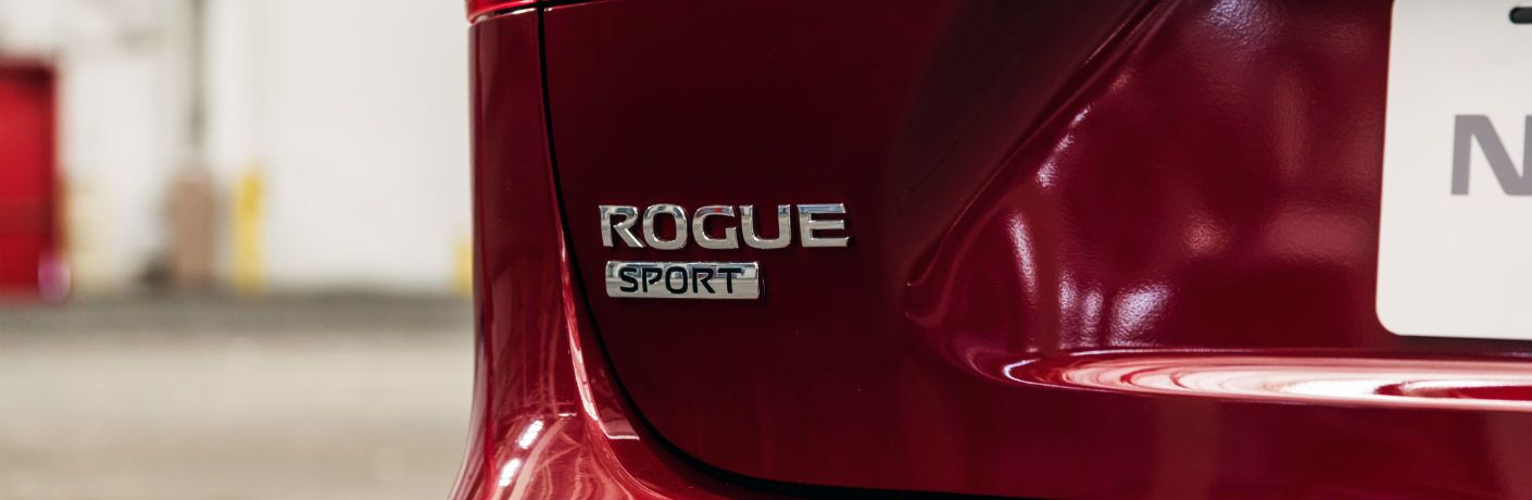 A photo of the Rogue Sport badge used by the 2020 Nissan Rogue Sport.