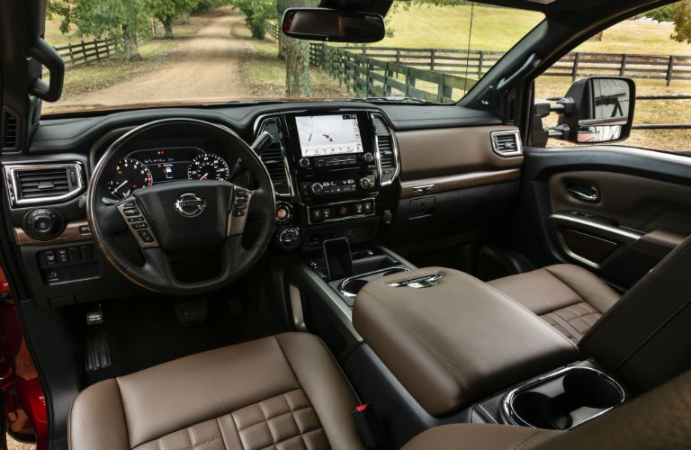 A photo of the dashboard and driver's cockpit in the 2020 Titan XD.