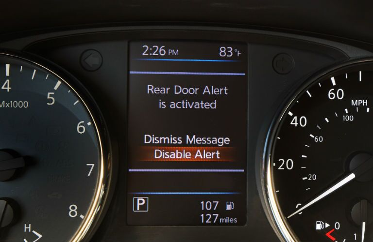 A photo of the Rear Door Alert message in the MID of the 2020 Nissan Rouge.
