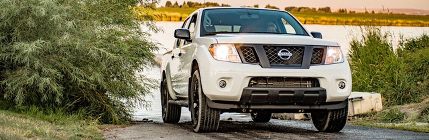 person driving 2019 Nissan Frontier away from water