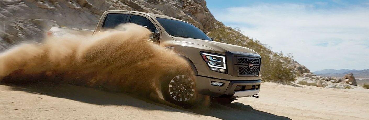 2020 Nissan Titan driving through a desert