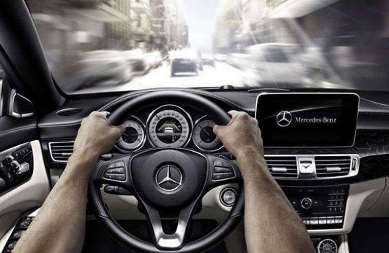 2018 Mercedes-Benz CLA steering wheel, gauge cluster, and infotainment screen