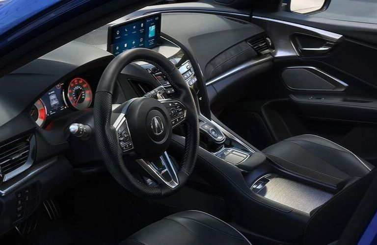 Interior view of the steering wheel and front seating area inside a 2020 Acura RDX